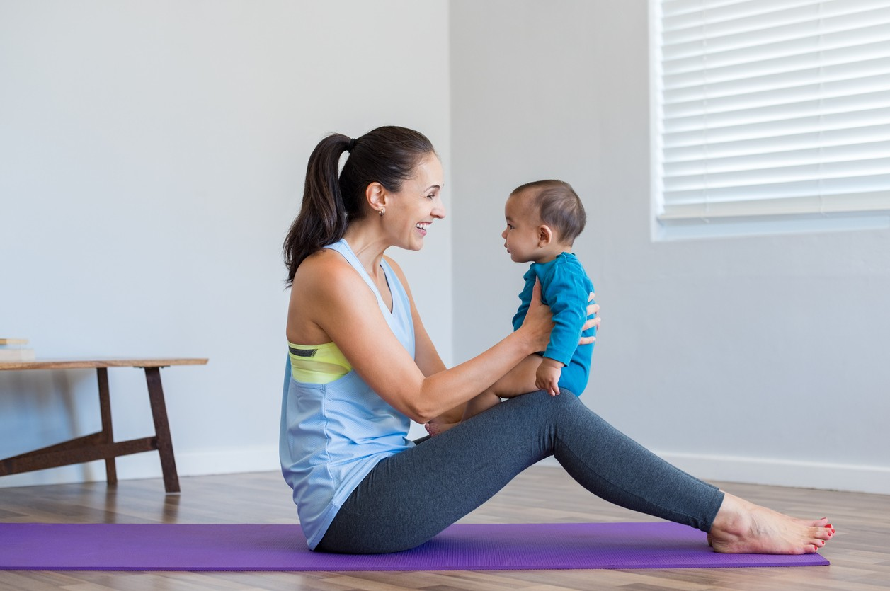 Woman doing yoga with son